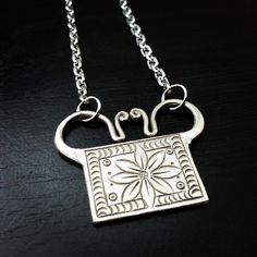 """Lotus Soul Lock Necklace with a custom 30"""" silver chain. Find this and similar items on my website. For custom requests, send me a Facebook message or email.   http://lovetgxc.tictail.com   http://tgxc.etsy.com   #tgxc #fashion #style #jewelry #xauv #bracelet #necklace #Asian #hmong #miao #hilltribe #nomad #silver #flowers #love #soullock #spirit #soul #amulet #etsy #handmade #fairtrade #igdaily #instafashion #instagramhub #accessories #musthave #instalike #women"""
