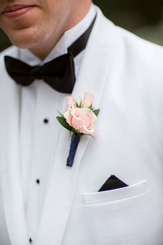 Preppy Nautical Wedding on Bald Head Island, Groom in White Dinner Jacket with Pink Rose Boutonniere | Brides.com