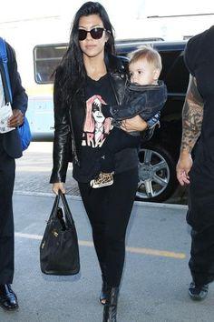 Kourtney Kardashian wearing Hermes Birkin Bag in Black, Saint Lauren Perfecto Leather Jacket, Stylestalker Grace Distressed Tee and Stuart Weitzman Koko Booties
