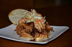 Pulled Pork and Carolina Slaw... perfect for a large gathering!  Step by step instructions with pictures.  #pulledpork #CarolinaSlaw #PartyFood