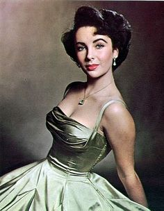 Elisabeth Taylor looking amazing. I love the bust of this dress, the term is a shelf bust.