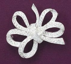Silver Plate Fancy Bow Fashion Pin, Clear Swarovski Crystals, 1-1/2 inch Silver Messages. $27.99. Save 26% Off!