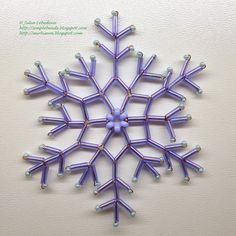 Free detailed tutorial with step by step photos on how to make a snowflake out of seed beads, bugle beads and wire. Great for beginners! Beaded Christmas Ornaments, Snowflake Ornaments, Christmas Snowflakes, Beaded Snowflake, Wire Ornaments, Snowflake Pattern, Seed Bead Tutorials, Beading Tutorials, Beading Patterns