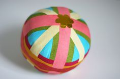 Surprise balls (balls that are wrapped up in crepe paper and you unroll them and find surprises) DIY via ohhappyday via Sandra Junto's blog