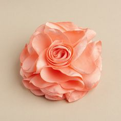 """Silk Flower Hair Clip or Pin in Orange:  Mariell's luxurious 3 3/4"""" round silk flower prom hair clip in orange cream has the look & feel of a real rose. It is an elegant hair accessory for bridal parties, prom or homecoming. There is also a pin on the back to wear on a gown or sash."""
