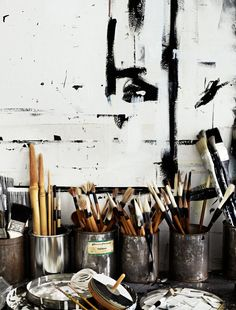 Brush strokes, tins and heaps of brushes.