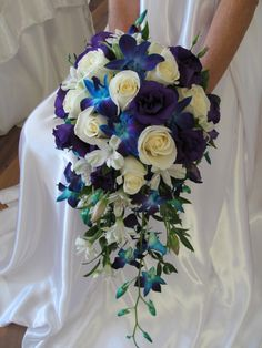 cascade of blue orchids,white roses,and alsrtoemeria