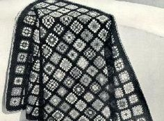 Mount Vernon Afghan- This Afghan is worked in four-inch squares in a variety of shades and can he made with odds and ends of yarn. There are 192 squares. Join them 12 squares wide and 16 squares long. Afghan 53 x 69 inches.