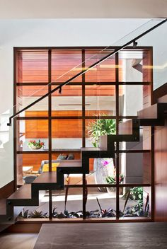 Floating #stairs with glass railing inside of a #modern #interior.  Very #zen!
