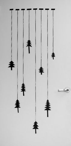 For our project, I'm thinking trees cut from paper and hung like this from a dowel or stick to hang in a window.