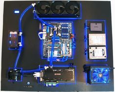 """This nicely put together wall-mounted PC is ultimately the goal of many custom computer builders. Recoil P -owner of this system- calls it """"The RecoilMachine"""", which took him over 2 months to order and assemble the rig. Also according to Recoil P, he uses Plexiglass as the backplate for each component before having them planted firmly on a large vinyl-clad hardboard. RecoilMachine has single loop water-cooling setup, Gigabyte EX58-UDP5, Intel Core i7 920 Socket-1366, Asus GTX 590, Samsung…"""