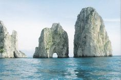 ☯ This is off the Almafi Coast in Italy. The Isle of Capri. These rock formations are called The Stacks!!