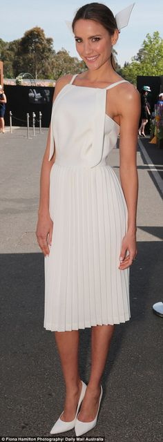 White hot: Models Ashley Hart and Rachael Finch were visions in white in very ladylike designs at Oaks Day 2014
