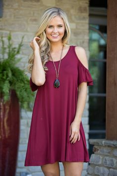 This sweet cold shoulder dress is calling your name this season! We adore the beautiful shade of burgundy red paired with the soft material - it's perfect for date night or a girls night out! It also
