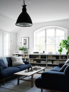 Living room with two deep blue sofas
