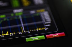 Close-up shot of the buy and sell buttons from an online stock market app