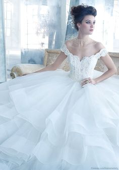Magnificent Lazaro ivory tulle ball gown, alencon lace bodice with off the shoulder lace straps, sweetheart neckline, circular skirt with layered hem, sweep train. 2013 (=)