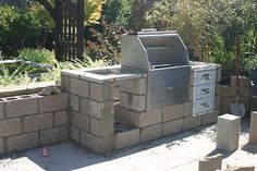 There are several methods and materials that can be used when making your Outdoor Kitchen. You can use concrete blocks bricks wood metal frame stucco and th Outdoor Kitchen Grill, Outdoor Kitchen Cabinets, Concrete Kitchen, Concrete Wood, Outdoor Kitchen Design, Concrete Blocks, Outdoor Kitchens, Bbq Kitchen, Brick Works