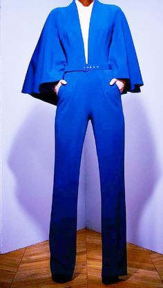Royal Blue cape Jumpsuit with belt Fabric: 97% Polyester, 3% lycra Size Chart: - 42 (L) - 40 (M) - 38 (S) - 36 (XS)