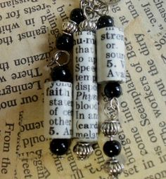 "DIY  Rolled Paper Beads  (No Tutorial - simply glue/cut paper and roll - you may want to roll around a wax paper covered pencil, etc.) each tube has a word and it's definition. This earring showcases""faith, humor and strength."""