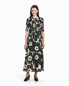 The pink, dark green and black Unikko pattern decorates the Leima dress, which is made of cotton with a hint of metal yarn to give the fabric a faint shine and firmness. The dress has a concealed zipper in the back seam and a gathered smock bodice and elb Most Beautiful Dresses, Marimekko, Dresses For Sale, Dress Sale, Women's Fashion Dresses, Pink Dress, Dress Skirt, Ready To Wear, Short Sleeve Dresses