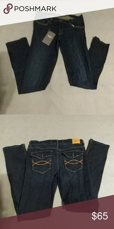 NWT Abercrombie & Fitch Jeans Perfect Stretch Jeans. Very Soft feeling Jean Mareial.  Eat 1892  New York Originals. Dark blue with the gold design on pockets. 5 pocket jean.  Button close back pockets. Has the original. A&F Tag on it but not a price tag. Didnt come with one in shipping.  Perfect Condition. Brand New. Abercrombie & Fitch Pants Skinny