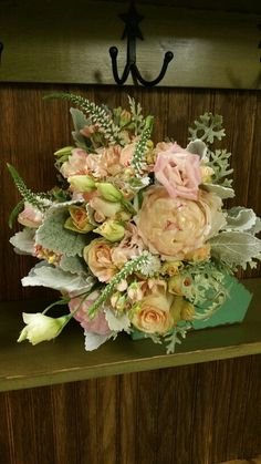Vintage style bouquet with peony, roses, veronica, stock, and dusty miller. Designed by Twig Floral Designs Carbondale IL www.twig-designs.com