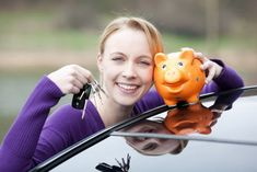 2woman looking happy she got really cheap car insurance coverage