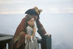 When we first meet Elizabeth, she has formed what everyone around her thinks is an unhealthy interest in piracy. She says meeting a pirate would be quite exciting. We think so too, which is why we're watching these movies about pirates.
