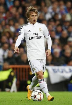 Real Madrid player, Luka Modric playing a shot....