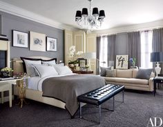 A chandelier by Williams-Sonoma Home overlooks the master bedroom | archdigest.com
