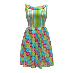 Colette Patterns Moneta Dress made with Spoonflower designs on Sprout Patterns. Snowflake Blocks by Floramoondesigns and Chili Pepper Stripe by Maryyx