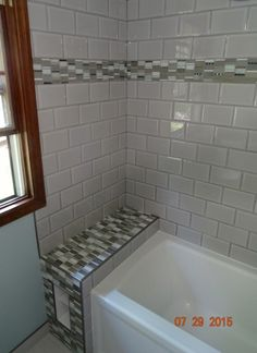 https://www.facebook.com/BeautifulKitchensbaths Beautiful bath remodel in Vadnais Heights, MN Accent tile, subway tile, floor tile, custom shelving, tub, shower, sink and fixtures install.