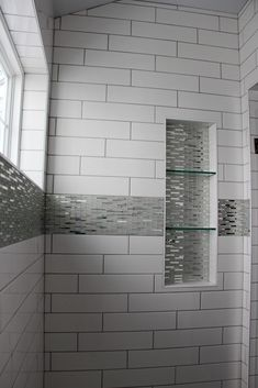 Tiled Shower Walls: Angora Soho, White, 4x16; Shower Accent: Mirror Glass, Silver SilverGrout: Mapei, Cobblestone