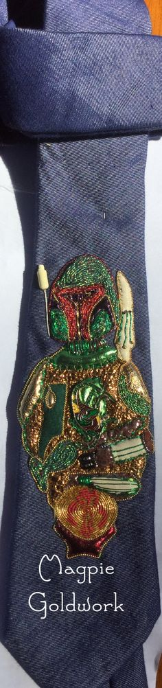Boba fett neck tie.Goldwork,vintage jewelry,leather. Made for my son,Rick. MagpieGoldwork.