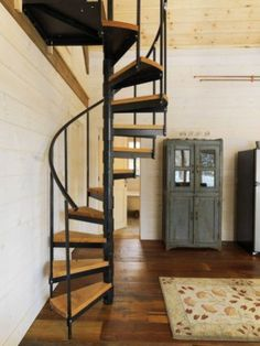 A spiral staircase is one of the … Vermont wood cabin — rustically delicious. A spiral staircase is one of the main architectural finds from a salvage shop in Vermont. Rustic Staircase, Wooden Staircases, Staircase Design, Spiral Staircases, Stair Design, Staircase Ideas, Small Staircase, Staircase Outdoor, Staircase Pictures