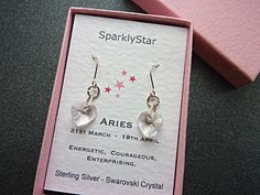Aries Birthstone Earrings. Sterling silver dangly earrings with clear Swarovski crystal hearts. These elegant and sparkly drop earrings are
