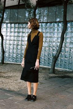 Layering a hot midi dress over patent leather oxfords and a tobacco drab turtleneck is a masterful grannie chic move. via Caves Collect