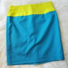 Prabal Gurung Neon & Blue Summer Pencil Skirt Sz 2 *Join with code HMOIX for a $5 credit towards your first purchase!  *Excellent condition *Prabla Gurung for Target *Half Lined Hidden Zipper *Neon Lime and a Vibrant Blue Color Block *Polyester, Rayon, Spandex blend  *Machine Washable *Size 2  •Waist: 14in •Length: 18in •At Thighs: 17in  *Condition score 8 of  10 -tiny fabric dent on back from hanger.  **Please feel free to ask questions or make offers 👯 Prabal Gurung for Target Skirts Mini