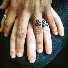 Add a typographical element to your wedding band tattoo idea with an ampersand.