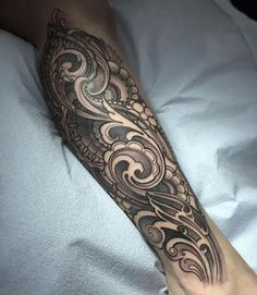 Laura Jade - Ornamental filigree calf tattoo