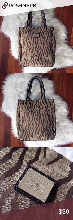 """Liz Claiborne Tiger Animal Print Tote Bag Purse Hard to find Liz Claiborne tiger print tote! Magnetic snap closure. Divided interior with zipper compartment. Measures 13"""" wide, 14.5"""" height, up to 5.5"""" depth. Has snap buttons on each side to expand purse and allow extra room. EUC. No visible wear or stains. Handles in great condition. See photos. Non smoking home. Liz Claiborne Bags Totes"""