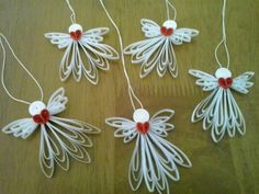 Here are my little paper quilled angels. Easy to make and very cute