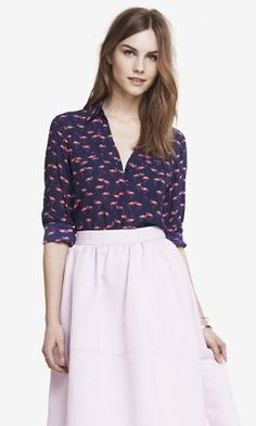I have this shirt, but I don't know what to match it with for shorts or skirts. The flamingos are kind of hot coral, instead of being hot pink.