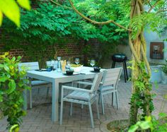 A courtyard with garden chairs, tables