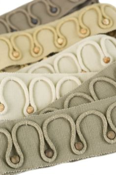 "Borders, Braids & Tapes: Embellished with a linen insertion cord, Marang is a 2 ½"" border with wooden beads made mostly of linen. #fabricut #trimmings"