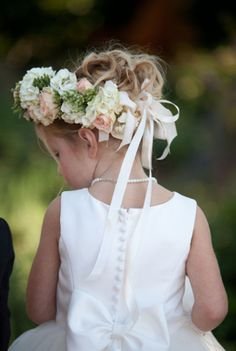 Flower girl Idea using a big wreath of flowers in hair accompanied with ribbon to drap across the back. Cute!