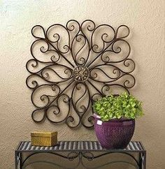 SCROLLWORK WALL DECOR Give your wall a dramatically stylish makeover simply by hanging this impressive iron decor. Curling waves of wrought iron wisp and wander from the center metallic ornament to make a modern statement. Wrought Iron Wall Decor, Metal Wall Decor, Diy Wall Decor, Wall Decorations, Toilet Paper Roll Art, Toilet Paper Roll Crafts, Tissue Roll Crafts, Art Mural En Fer, Decoration Shabby