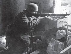 German Fallschirmjäger defending a position. Date unknown.