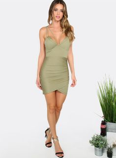 "All eyes will be on you in the Strappy Mini Dress! Features thin straps, back zipper, metallic details and a body hugging silhouette. Dress measures 26"" from shoulder to bottom hem. Wear with thigh high lace up heels and voluminous curls for a standout ensemble. Modeled in a size S."